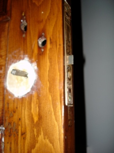 Wood plug to fill bored door hole